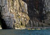 The kayaks approach the cliffs