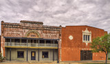 An old movie theater and adjacent bldg. in Refugio, TX