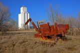 Kanora, KS grain elevator & old combine.
