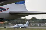 John Travolta's Eclipse 500 N218JT behind the Historical Flight Foundation's DC-7B N836D at Opa-locka Executive Airport