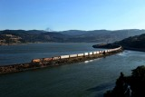 Eastbound BNSF train curves along the Columbia River.