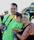 Shelly before the swim start with husband Remy and son Jensen
