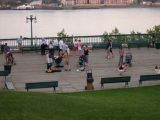 A street performer on  the Terrasse Dufferin (boardwalk). The St. Lawrence River is in the background.