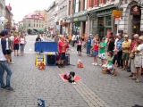 A street performer entertains the crowd with his dogs on Rue St.-Jean in the Upper Town section of Old Québec.