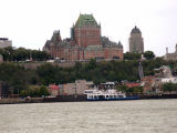 Photo from a ferry going from Québec City to Lévis. In the background - Lower Town, Le Château Frontenac and another ferry.