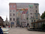The Fresque des Québecois, a 4,665 square foot mural  on the side of a building near Place Royale.