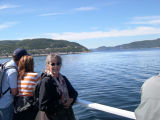 Judy on a boat on the St. Lawrence River heading to the whale watching areas.