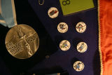 1980 Olympic Medal (silver?) and souvenir pins from the Lake Placid Olympic Winter Games.