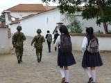 Military boys and schoolgirls