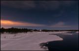 Nightphoto at Kaalasluspa. Lights from Kiruna City colors the sky