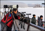 Old-fashioned Japanese photographer (panorama specialist?) waiting for cranes to act