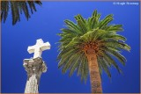 Spain - Extremadura - Caceres - Cross and blue sky