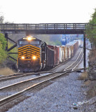 NKP 8100 leads NS 124 North, under the Buster pike bridge at North Wye