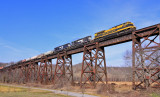 3 Generations of EMD power cross the Green River bridge and start up the hill to Kings Mountain