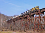 NS 1069 leads a pure EMD power set and train 117 across the Green River Bridge at Southfork KY