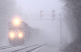 The wind and heavy snow have visibilities down to almost nothing as NS 177 powers through a winters morning at Junction City.