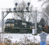NS 177 rolls down Norwood hill in a light snow as Mr. Hoyden gets his shot of the train and those classic Southern signals