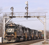 A standard cab SD70 leads NS 295 under the signals at Juntion City
