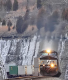 Train 229 flies up Kings Mountain, surrounded by ice in the cut