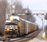 A lone GE struggles to keep a mile of empty racks moving as they pass through the interlocker at Waynesburg