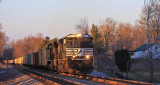 A pair of new EMD's lead train 890 South in the last light of the day