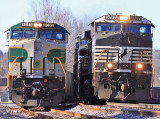 Northbound NS 142 passes Southern 8099 at the North end of Oneida yard