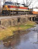 Lackawanna 1074 trails train 23G along Town Branch creek in Harrodsburg