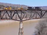 A lone EMD brings a CAT High/Wide train over the Cumberland River bridge at Burnside.