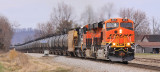 NS 68K grinds up Moreland Hill with a new BNSF GE on the point