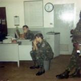 04 - K. C. Szmall sitting at desk, far left.