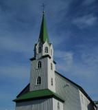 Church tower by City Pond Reykjavik poss Stoffnun Frikirkja