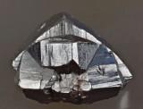 Cassiterite, 22 mm polycyclic twin on 45 mm matrix. Copes Creek, Tingha Tinfield, Hardinge County, New South Wales, Australia.
