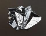 15 mm cassiterite cyclic twin, Cornwall, probably Bunny Mine, St Austell.