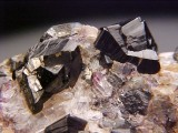 Cassiterite cyclic twins on 7 cm matrix. Zinnwald, Erzgebirge Krusne Hory Mts, Saxony & Usti Region, Germany & Czech Republic.
