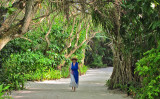 Gloria walking the planted sand path to our room