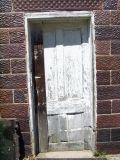 white weathered door