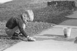 Kid: spring cleaning Simcoe sidewalk - Date: 22 BV (Before Videogames)