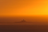 Lighthouse in the Sunset Mist