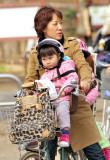 Fierce Oca-San Cyclist, Not So Convinced Toddler...