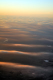 Sunset Over a Sea of Thin Clouds