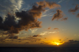 12.  A sunset from our little balcony while cruising south.