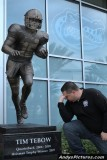 Tebowing in front of the Tim Tebow sculpture