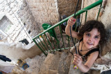 Girl atop stairs - Hebron