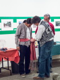 Ben Shendo receiving ceremonial sash from Visiting Scholar Dr. Dan McDonald