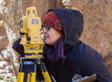 Kristin Corl using the total station