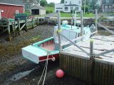 A BOAT AT ANNAPOLIS ROYAL AT LOW TIDE-IT IS AMAZING THAT THEY DON'T FALL OVER
