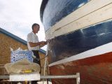 BINDING THE SEAMS ON REG'S BOAT-WE TALKED TO THIS GUY FOR AN HOUR