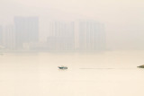 lone boat in smoggy harbour