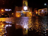 Annan  Old  Town  Hall, reflecting  in  a  puddle.