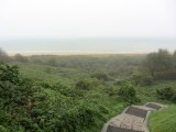 the view out to Omaha Beach from the cemetery is foggy and quiet today